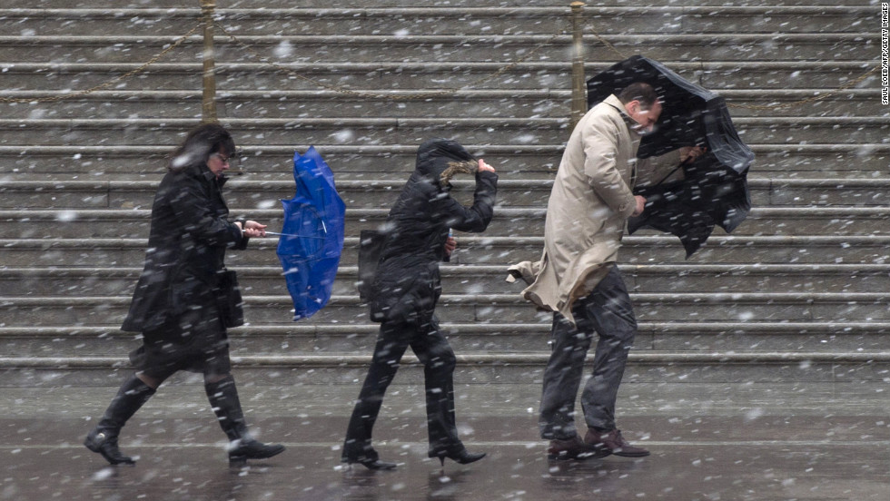People walk as snow falls at the U.S. Capitol in Washington on Wednesday, March 6.