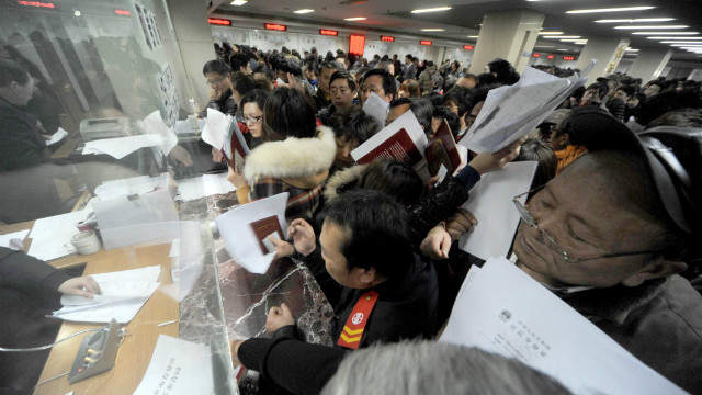 People crowd into the Nanjing Municipal Real Estate Trading Centre looking to sell property ahead of a tax policy change on March 4, 2013 in Nanjing, China.