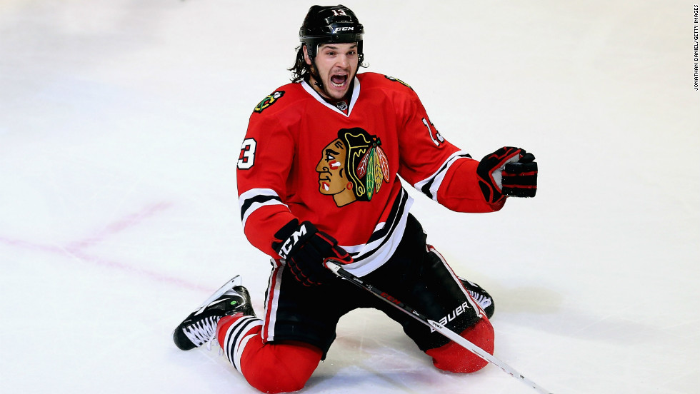 Daniel Carcillo of the Chicago Blackhawks celebrates his game-winning goal against the Colorado Avalanche on Wednesday. The Blackhawks won 3-2.