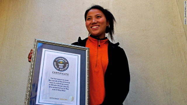 Chhurim Sherpa holds the certificate she received recognizing her double Everest ascent.