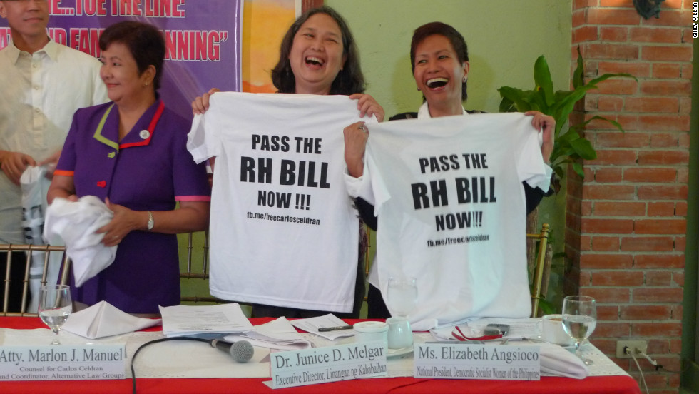 Elizabeth Angsioco, right, holds up a T-shirt pushing for passage of the Philippine Reproductive Health (RH) bill, which passed in December 2012. The National Chairwoman of the Democratic Socialist Women of the Philippines (DSWP) says her biggest fear is that the new pope will be from her own country.