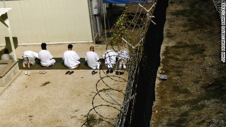 Muslim detainees kneel during early morning prayer on October 28, 2009.