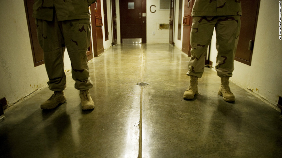 Members of the U.S. Navy move down the hallway of Cell Block C in the Camp 5 detention facility in January 2012.