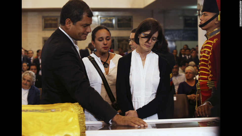 Ecuadorian President Rafael Correa views Chavez's body with his wife Anne Malherbe, right, on March 7.