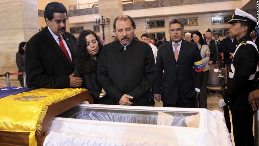 Nicaraguan President Daniel Ortega, center, views Chavez's body with his wife, Rosario Murillo, second left, on March 7.