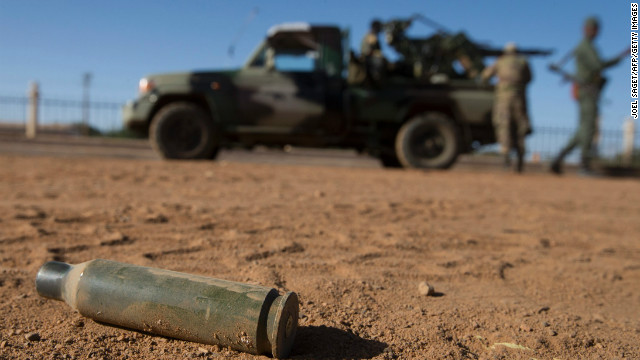 (File) A cartridge lies on the floor next Malian soldiers on February 22, 2013 in Gao, northern Mali.