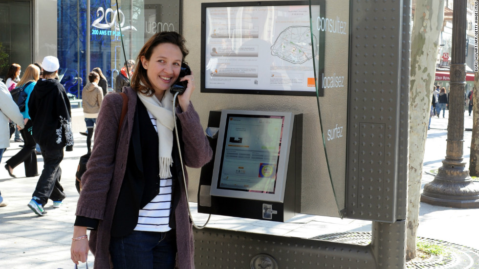 Other cities around the world have already introduced hi-tech phone booths to their busy streets and thoroughfares. In this picture, a woman makes a phone call at a pay phone equipped with a touchscreen and Internet connection on the Champs-Elysees in Paris, France.