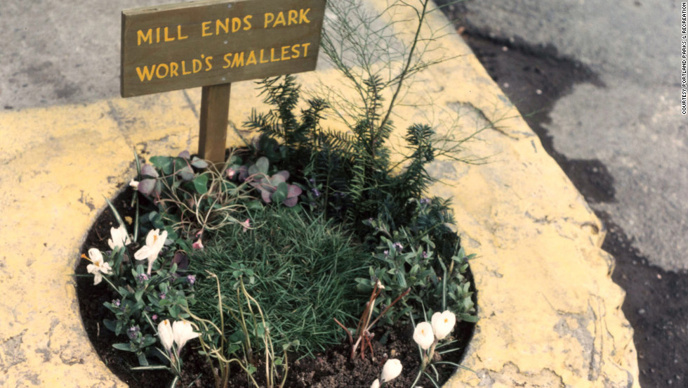 "The Portland Parks and Recreation department took over care and maintenance of Mill Ends park in 1976. The park was dubbed ""World's Smallest Park"" by Dick Fagan, a writer for the Oregon Journal who first planted flowers there. This is how the park appeared in 2001."