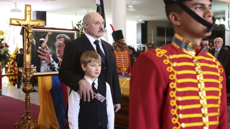 Belarus President Alexander Lukashenko and his son Nikolay stand next to the coffin of Chavez during the funeral on March 8.