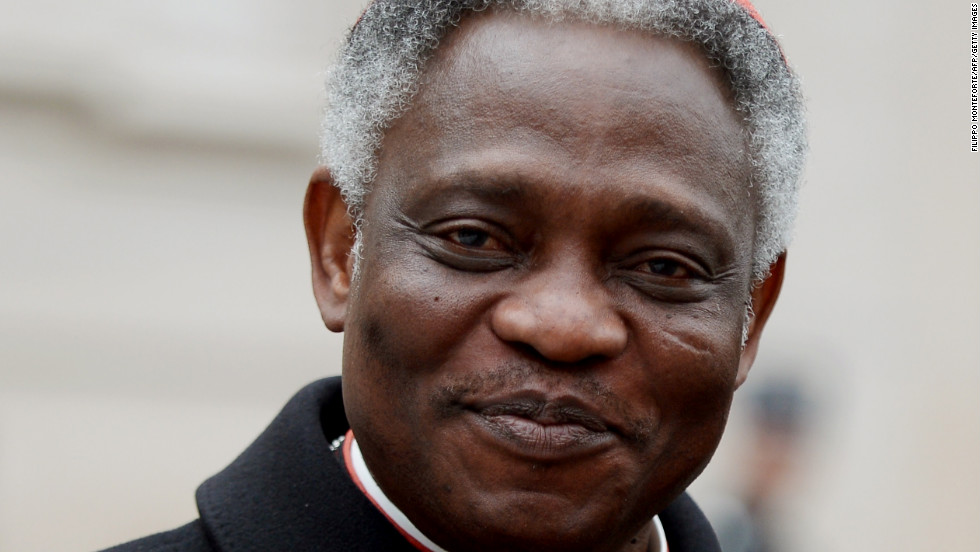 Cardinal Peter Kodwo Appiah Turkson of Ghana arrives at the Vatican on March 8.