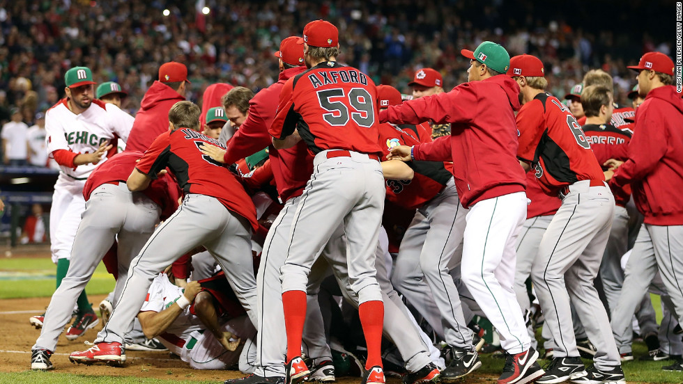 Players and coaches from Mexico and Canada converge in an on-field brawl during the World Baseball Classic on March 9.