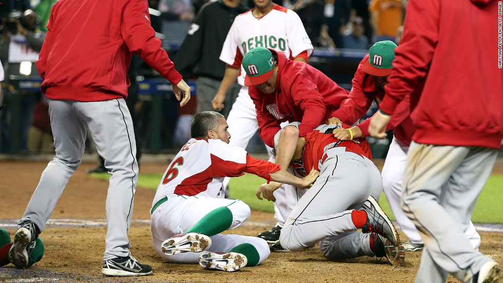 Pitcher Oliver Perez (left) and coaches of Mexico attempt to subdue Scott Mathieson of Canada during a brawl at the World Baseball Classic on March 9.