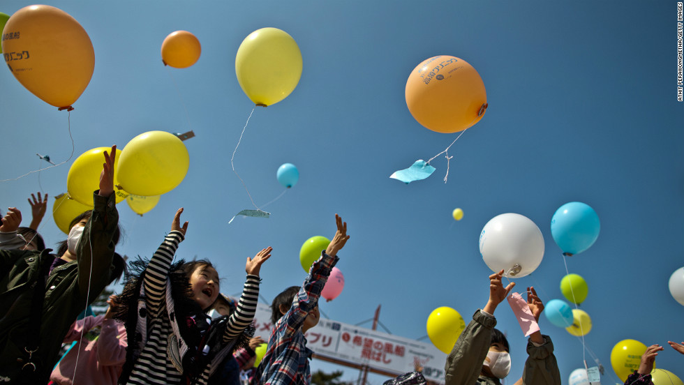 Children in Minamisoma, Japan, float balloons while paying respects on Sunday, March 10, a day before the second anniversary of the disaster.