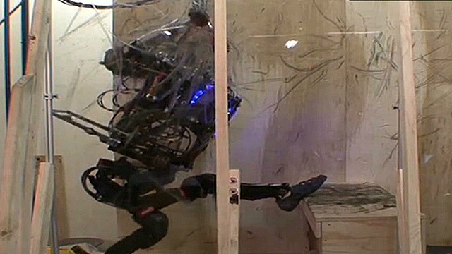 New military robots show off strength