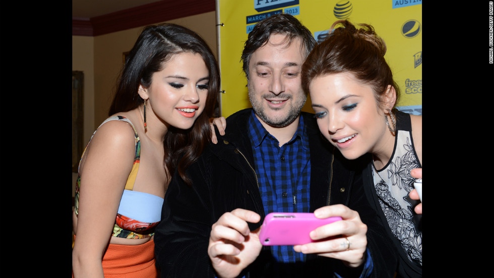"Actress Selena Gomez, left, director Harmony Korine and actress Ashley Benson gather in the green room to discuss their film ""Spring Breakers"" on Tuesday, March 10."
