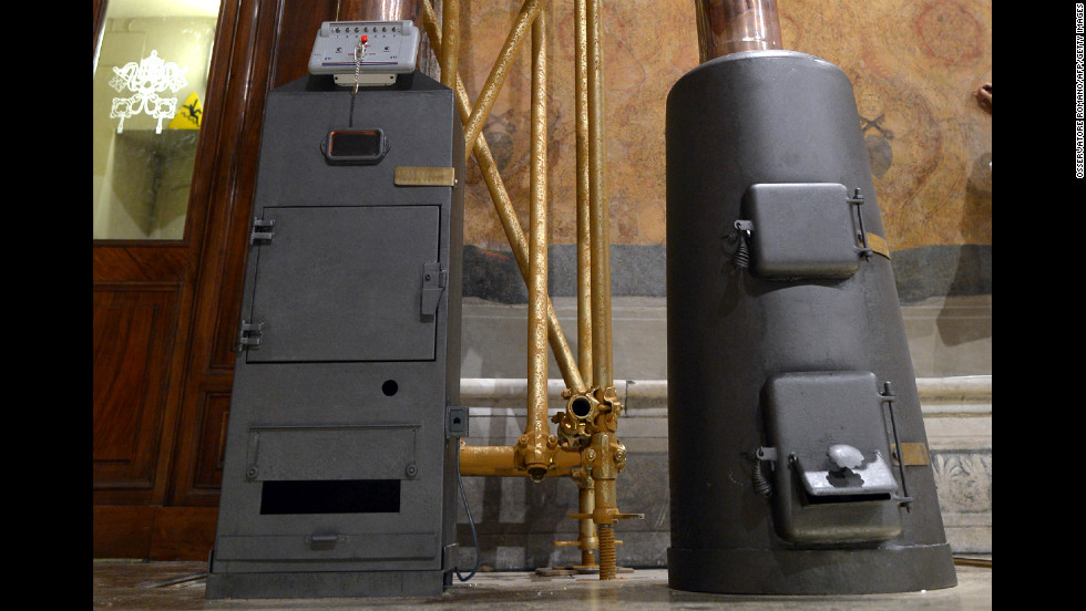 The initial announcement that a new pope has been chosen will come from a puff of white smoke resulting from a secretive ceremony involving a cast iron stove, seen on the right on March 8 inside the Sistine Chapel.