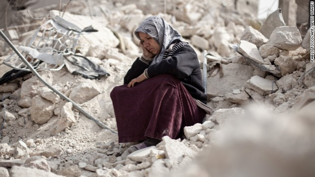 Syrian Zakia Abdullah sits on the rubble of her house in the Tariq al-Bab district of Aleppo, Syria, on February 23, 2013.