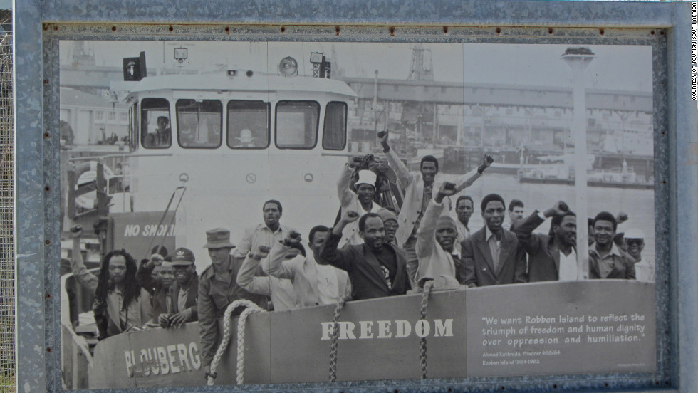 "Photograph of former Robben Island prisoners. Ahmed Kathrada, senior ANC leader and close friend of Nelson Mandela during their time in prison, said on their release, ""We want Robben Island to reflect the triumph of freedom and human dignity over oppression and humiliation."""