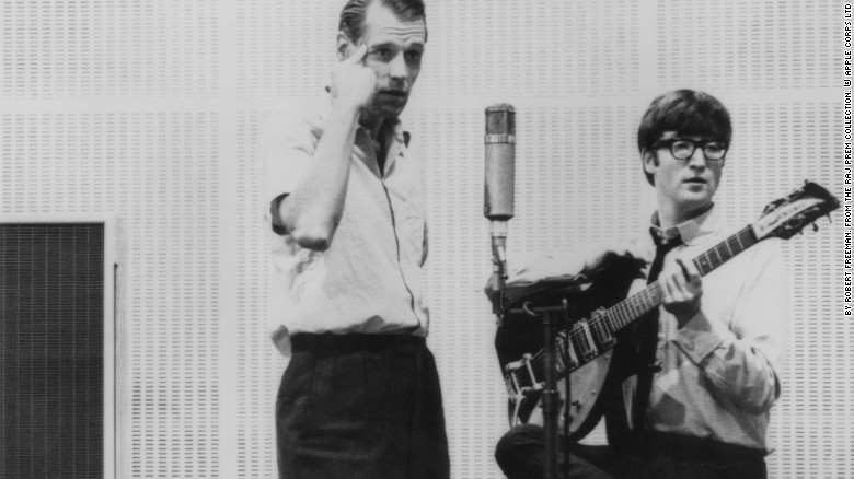 """<a href=""""http://www.cnn.com/2016/03/09/entertainment/george-martin-obit/index.html"""">Sir George Martin</a>, the music producer whose collaboration with the Beatles helped redraw the boundaries of popular music, died Tuesday, March 8, according to his management company. He was 90. He's seen here in the studio with John Lennon."""