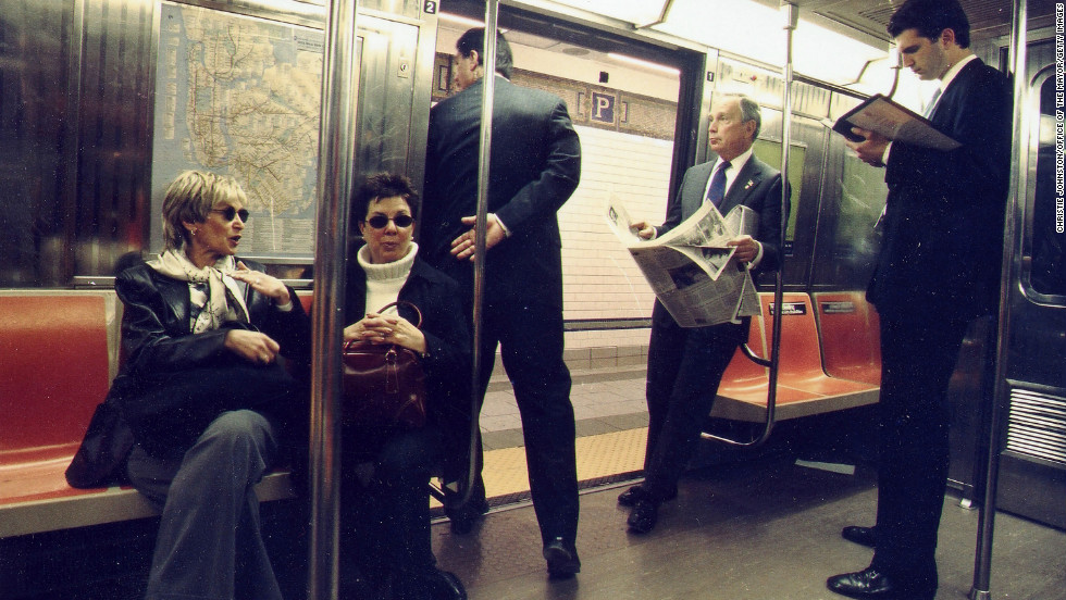 "Bloomberg, second from right, rides to City Hall on the R train in March 2002 after New York transit workers authorized union leaders to call a strike. Bloomberg, dealing with a $1 billion budget shortfall, had refused union demands for a 24% wage increase over three years. The strike was <a href=""http://articles.cnn.com/2002-12-16/travel/nyc.transit.strike_1_transit-workers-union-president-roger-toussaint-nyc-transit-strike?_s=PM:TRAVEL"">called off</a> in December 2002 after transit workers and their management worked out a deal."