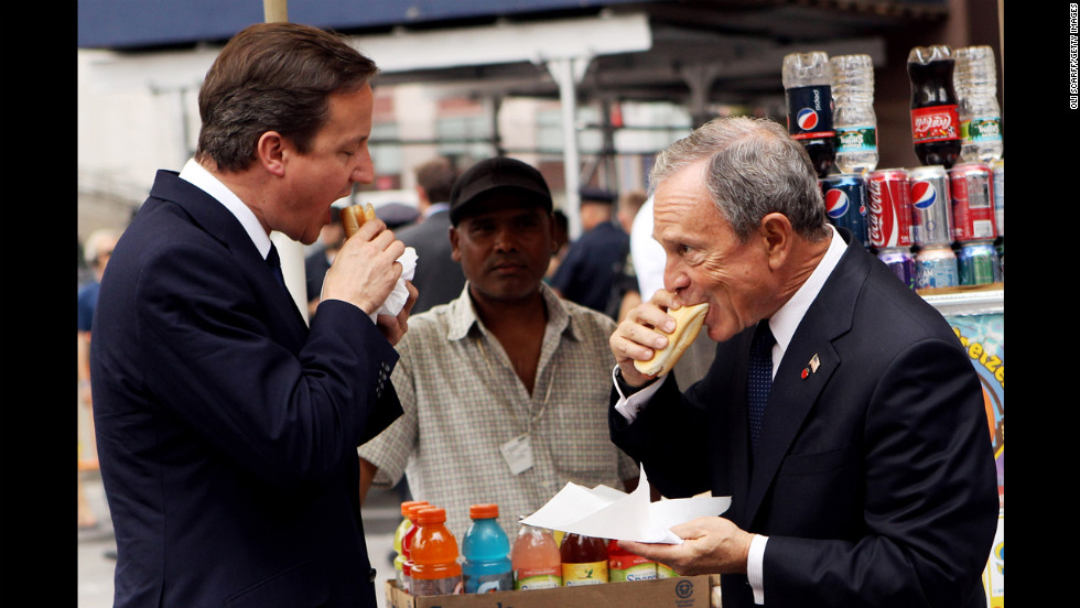 British Prime Minister David Cameron eats a hot dog with Bloomberg outside New York's Penn Station on July 21, 2010. Cameron met with Bloomberg and U.N. Secretary General Ban Ki-moon during his visit to New York.