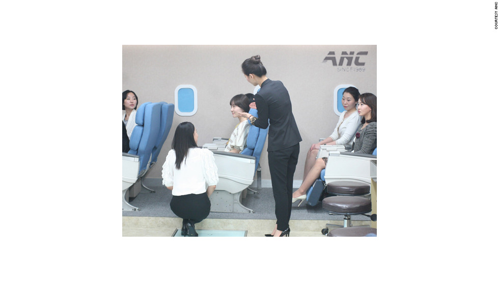 At the ANC flight attendant academy in Seoul, South Korea, students role play in a classroom simulating a plane.