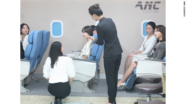 At ANC flight attendant academy in Seoul, students practice role-playing in a classroom simuating a plane.