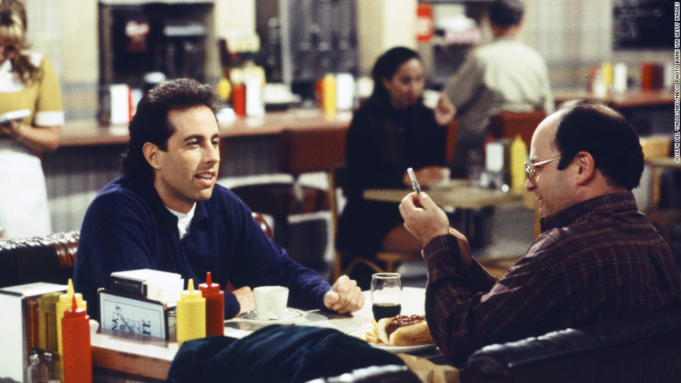 "True, ""Seinfeld"" also technically launched in 1989 -- but what are the '90s without Jerry Seinfeld (left), George Costanza (played by Jason Alexander, right), Kramer and ""<a href=""http://www.youtube.com/watch?v=DY_DF2Af3LM"" target=""_blank"">The Elaine</a>""?"