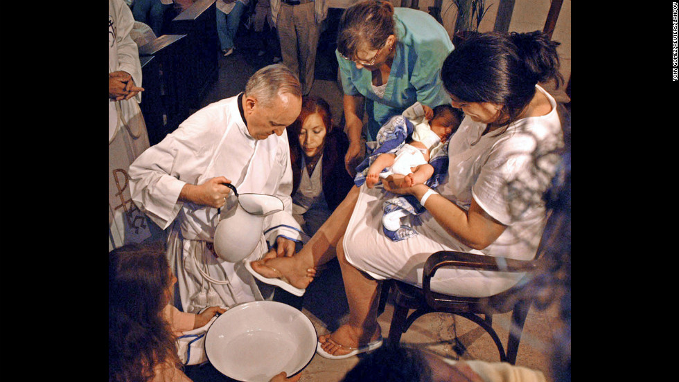 Bergoglio is shown washing the feet of a woman on Holy Thursday at the Sarda maternity hospital in Buenos Aires in 2005.