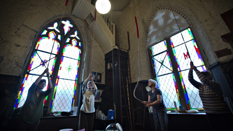 Parishioners ring the 100-year-old bells in the tower of Holy Rosary Cathedral in Vancouver in honor of the new pope.