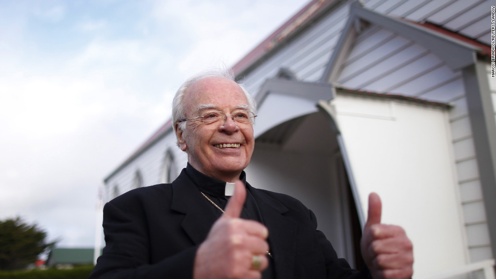 Catholic Monsignor Michael McPartland gestures his approval outside St. Mary's church after learning of newly elected Pope Francis in Stanley, Falkland Islands.