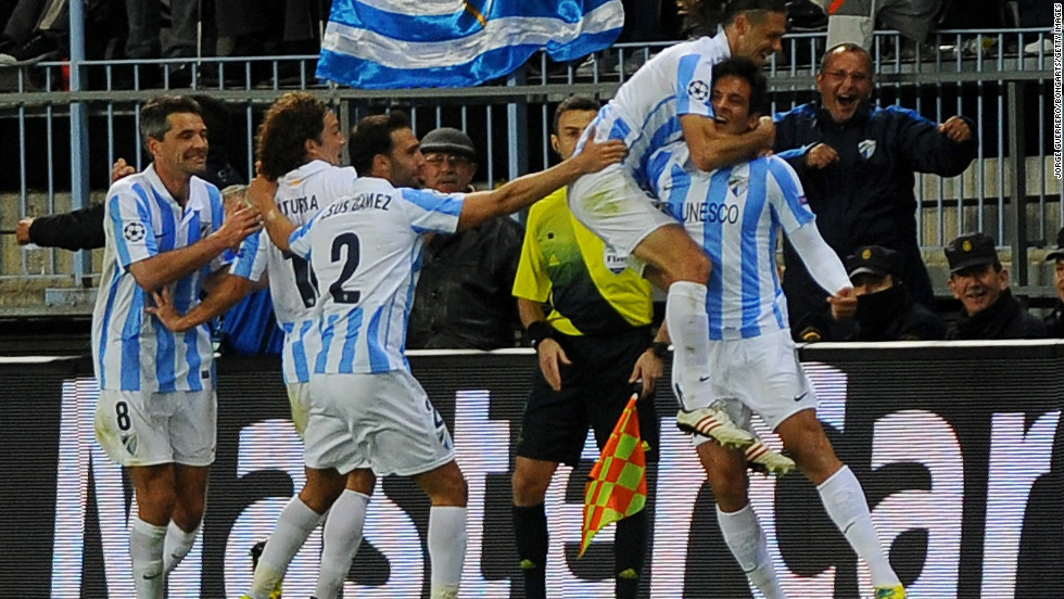 Substitute Roque Santa Cruz netted a 77th minute winner to make it 2-0 on the night and send Malaga through 2-1 on aggregate.