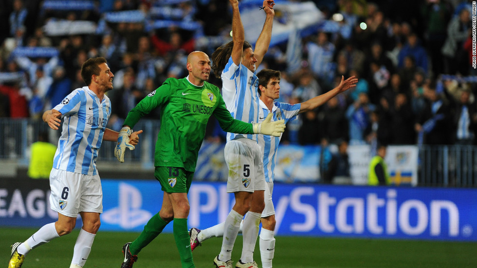 Malaga's players celebrate at the final whistle following the 2-0 win over Porto -- a result which secured a 2-1 aggregate victory overall and its place in the quarterfinals for the first time in its history.