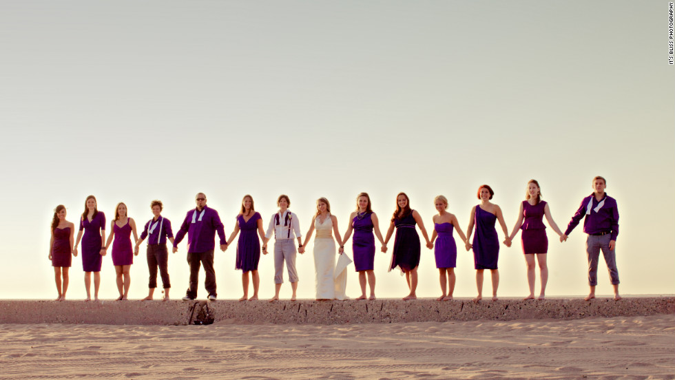 "Group shots can be overly posed or dryly composed, but they don't have to be. The image chosen for the book's cover ""offers the simplicity of the horizon and the steadfast strength of community,"" Hamm says. From the mix of attire styles and colors, this gender-blended wedding party shows unwavering unity amid the embrace of individuality."
