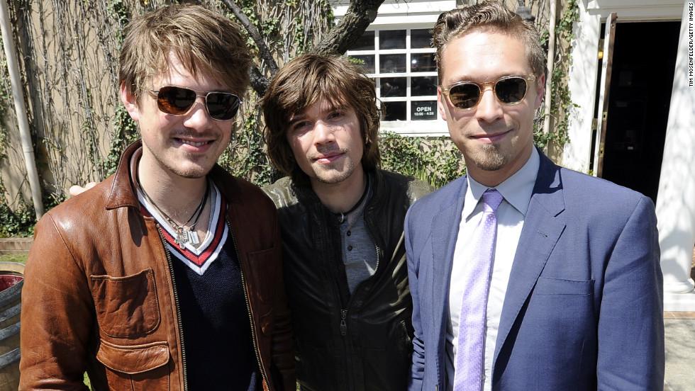 In 2011, Taylor, Zac and Isaac pose at a vineyard in Napa, California.