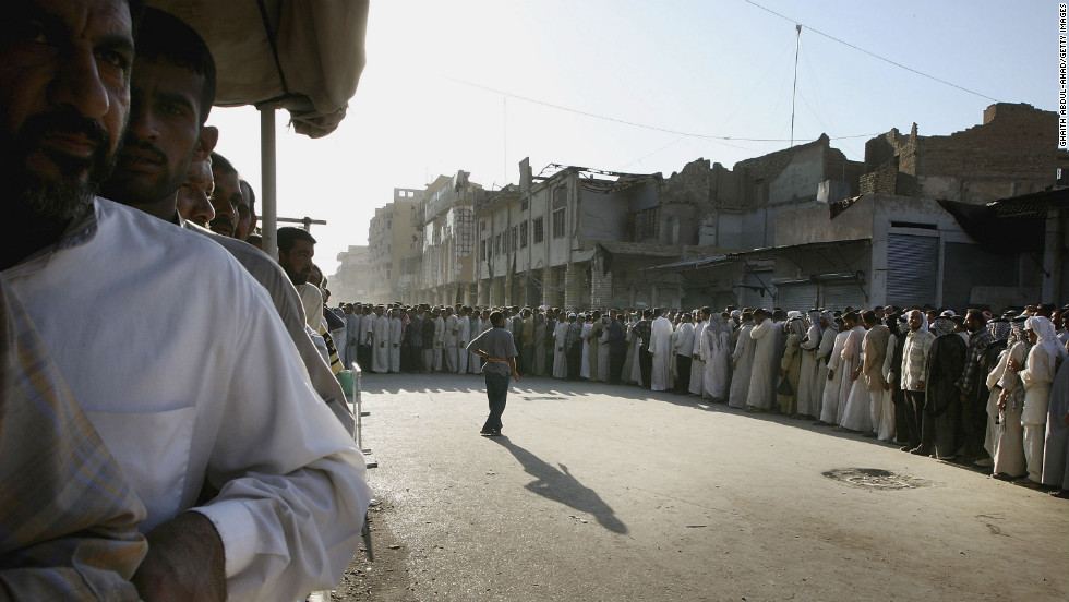 Iraqi Shiite faithful gather in Najaf on August 27, 2004, to mark the end of a battle. Rebel leader Muqtada al-Sadr ordered his fighters to lay down their arms in a peace deal brokered by Iraq's most revered Shiite cleric, Grand Ayatollah Ali al-Sistani.