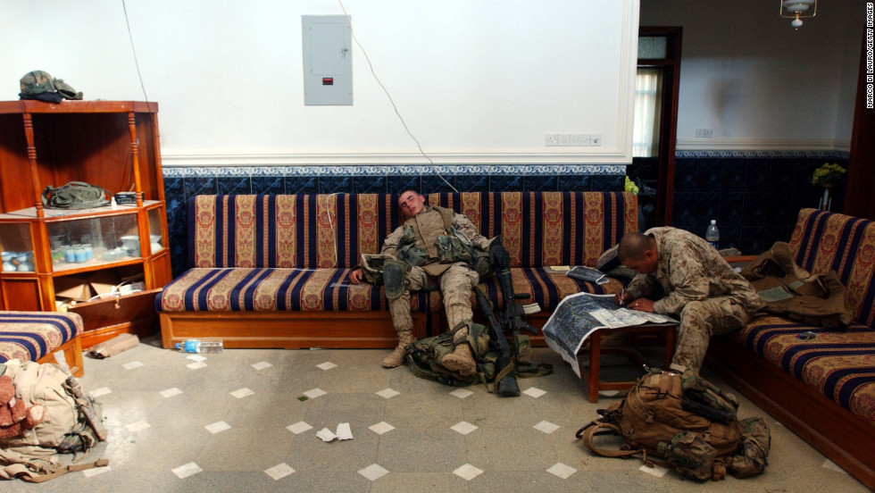 Marines rest and check a map in a house during an offensive in Fallujah on November 11, 2004.