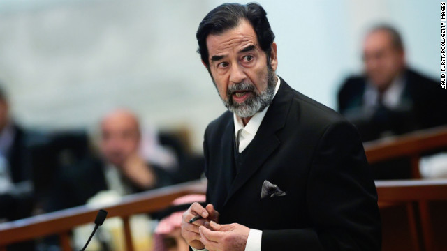 BAGHDAD, IRAQ ? OCTOBER 17: Ousted Iraqi leader Saddam Hussein adresses the court during his trial in the heavily fortified Green Zone October 17, 2006 in Baghdad, Iraq. Hussein and six co-defendants have been on trial since August 21, 2006 for the Anfal campaign of bombings and gas attacks against Kurdish rebels in 1987-1988. It is believed the Anfal campaign left up to 180,000 dead.  (Photo by David Furst-Pool/Getty Images)