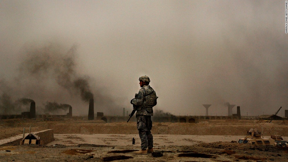 A U.S. soldier with 2nd Brigade, 1st Armored Division, stands on a kiln overlooking more than 150 brick factories in Narwan on July 1, 2008.