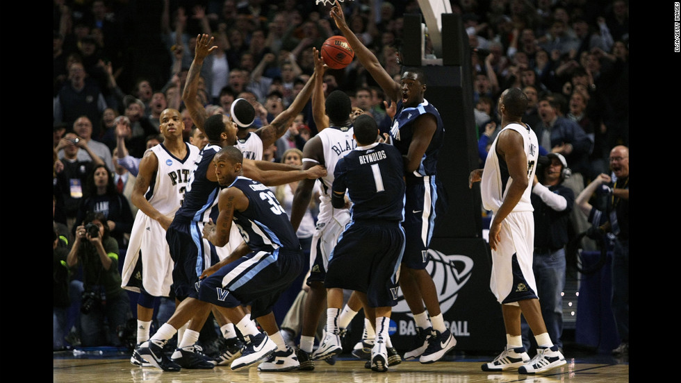 The Villanova Wildcats celebrate after Scottie Reynolds made the game-winning shot to beat the Pittsburgh Panthers 78-76 during the East Regionals of the tournament on March 28, 2009, in Boston.