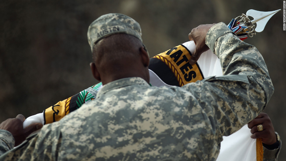 Gen. Lloyd Austin retires the United States Forces-Iraq flag during a casing ceremony at the former Sather Air Base in Baghdad on December 15, 2011.