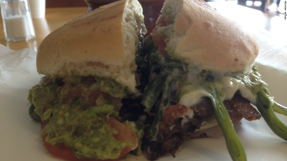 The first thing you notice about the chacarero from Chile is the pile of green beans sticking out from under the bun. Alongside this distinctive ingredient and thin-sliced beef or chicken, the chacarero piles tomatoes, avocado and mayonnaise in crusty Chilean bread. Pictured: chacerero from San Antonio Bakery #2 in Astoria, Queens, New York.