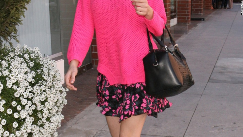 Emmy Rossum heads out in Beverly Hills.