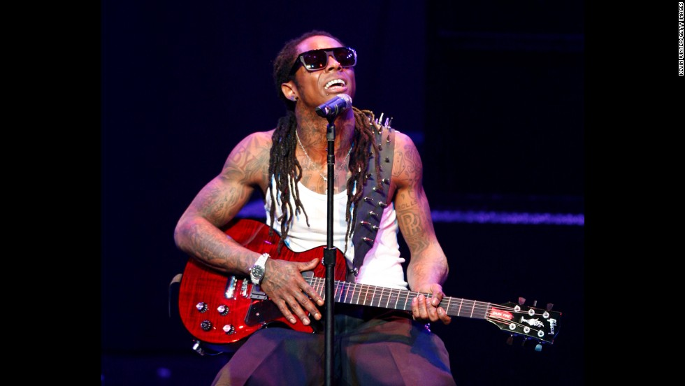 "Rapper Lil Wayne performs onstage during his ""I Am Music"" Tour at the Gibson Amphitheater on March 29, 2009, in Universal City, California."
