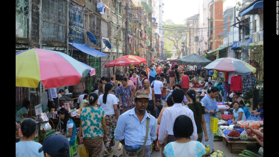 People shop at a local market in Yangon.