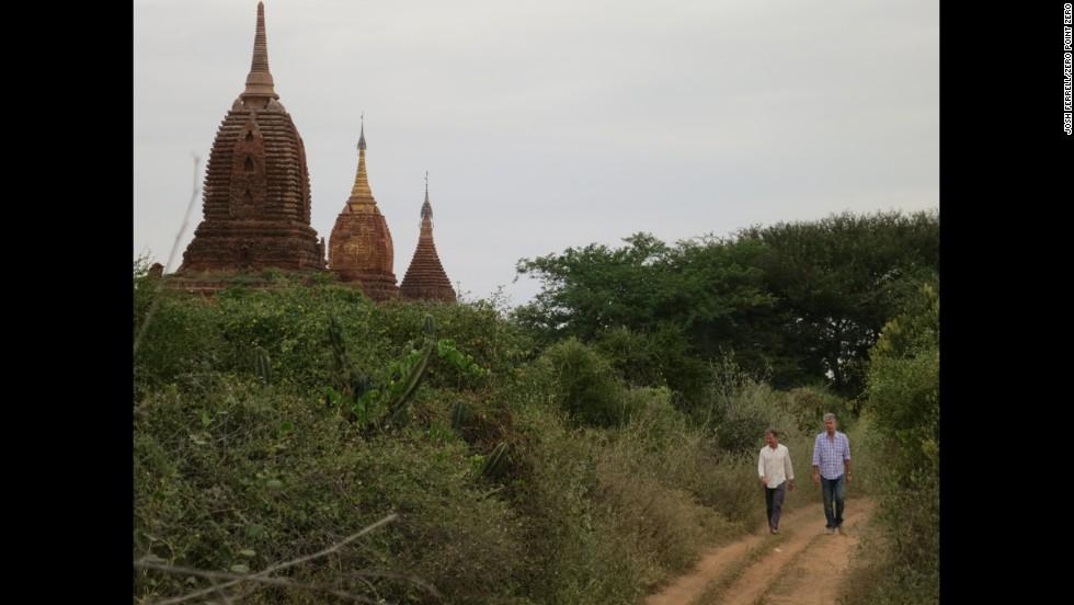Bourdain and Les Halles owner Philip Lajaunie walk around Old Bagan.