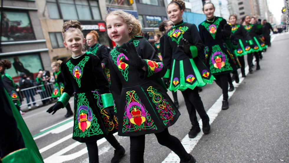 Young girls don Irish-inspired dresses as they participate in New York City's annual St. Patrick's Day Parade on March 16.