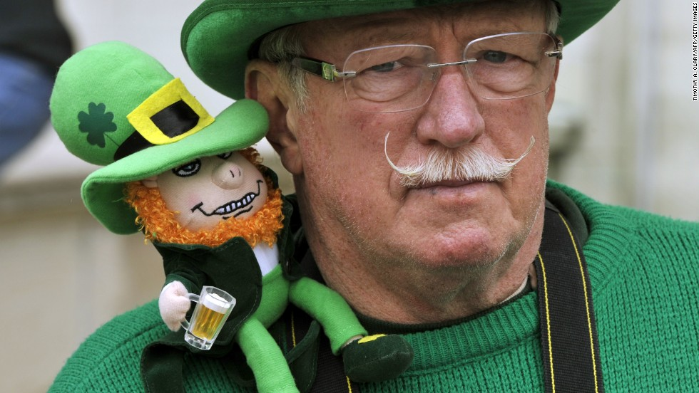 A very tiny leprechaun sits on the shoulder of a St. Patrick's Day reveler during the annual New York City parade on March 16.