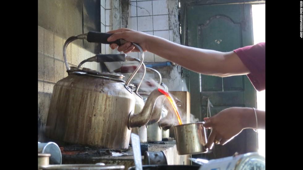 Teakettles pour at the Shwe Weh Tun Tea Shop in Yangon.