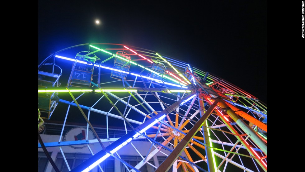 "At a festival in Myanmar, Tony spotted a unique carnival ride: A Ferris wheel driven by human power. He described the acrobatic, circus-like spinning as an ""insanely dangerous, closely choreographed process of first getting the giant, heavily laden wheel in motion and then getting it up to top speed and keeping it there."""